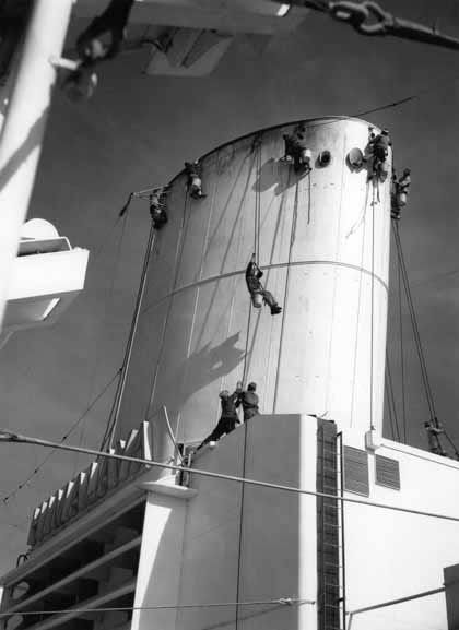 Seamen cleaning the funnel – 1950