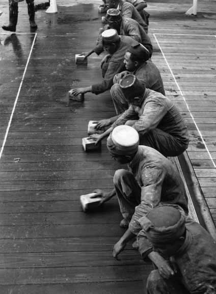 Lascar seamen holystoning the deck – 1950