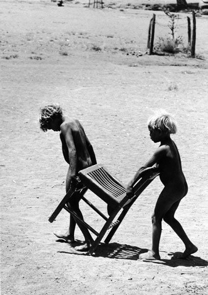 Pitjantjatjara children with chair, South Australia – 1963