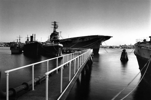 Aircraft carrier <em>Melbourne</em> at Athol Bay, dusk – 1985