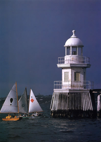 Sabot dinghies and harbour lighthouse – 1962