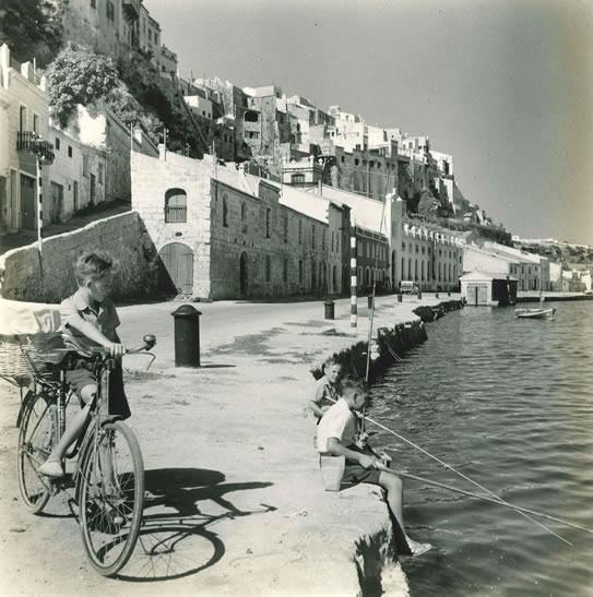Boy and bicycle in Spanish port – 1954