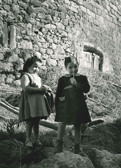 Spanish girls playing underneath tower, Costa Brava – 1955