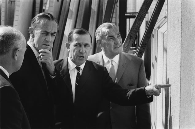 Ted Farmer (second from left), Charles Weatherburn (centre) and Davis Hughes discuss cladding options – c.1966