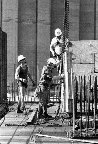 Merv Francis, Scott Wyatt and Mario Perkovic adjust chains for lift of precast concrete panel 3 – c.1993