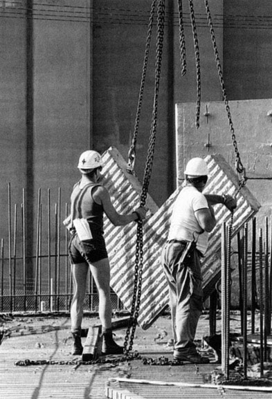 Merv Francis, Scott Wyatt and Mario Perkovic adjust chains for lift of precast concrete panel 4 – c.1993