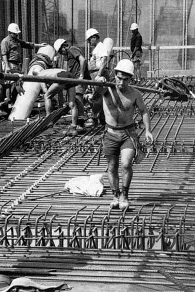Tony Figueredo carring scaffold pipe over reinforcing steel on western approach span – c.1993