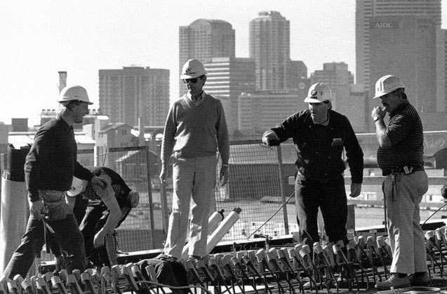 David Hardie, watching as foreman Trevor Weller directs work on western pier table – c.1993