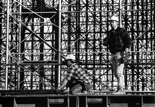 Mark Taylor and Craig Scott on skidbeam with background of Kingshore scaffolding – c.1994