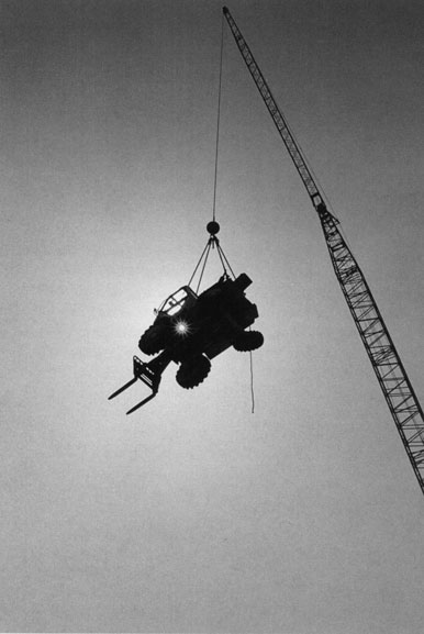 Crane swings forklift truck off deck – c.1994