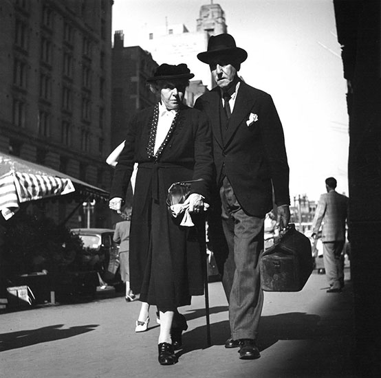 Elderly couple in street – c.1950