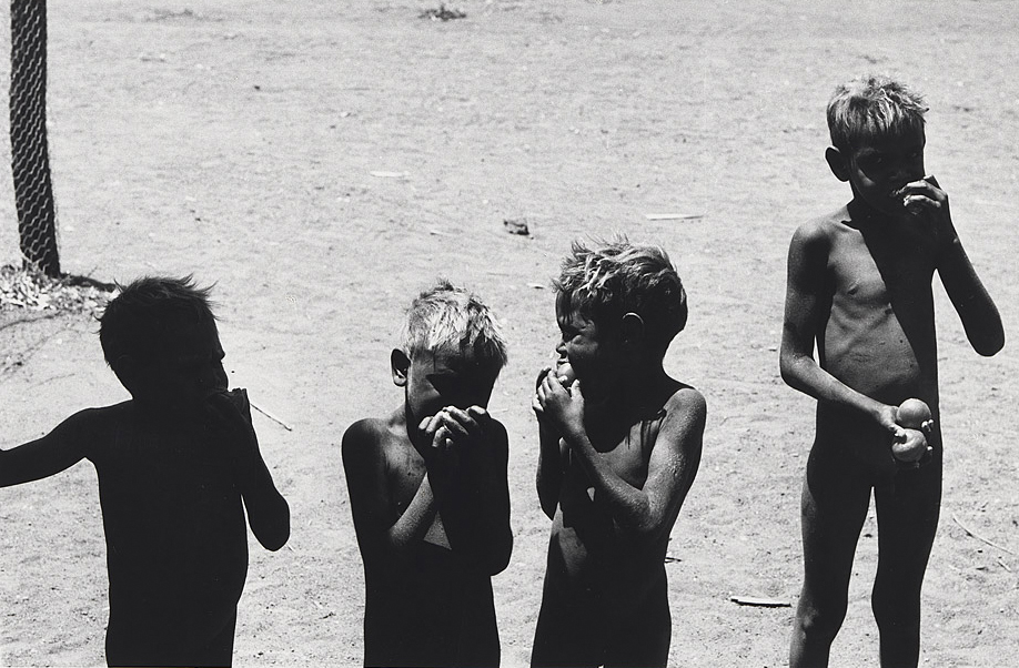Pitjantjatjara boys eating tomatoes – 1963